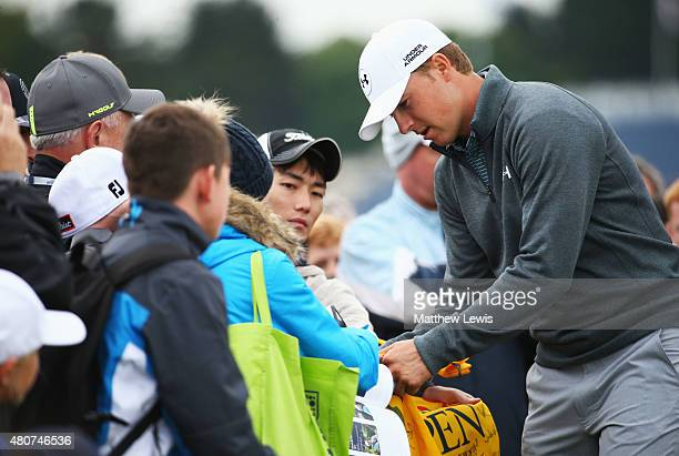 Jordan Spieth of the United States signs autographs during practice ahead of the 144th Open Championship at The Old Course on July 15 2015 in St...