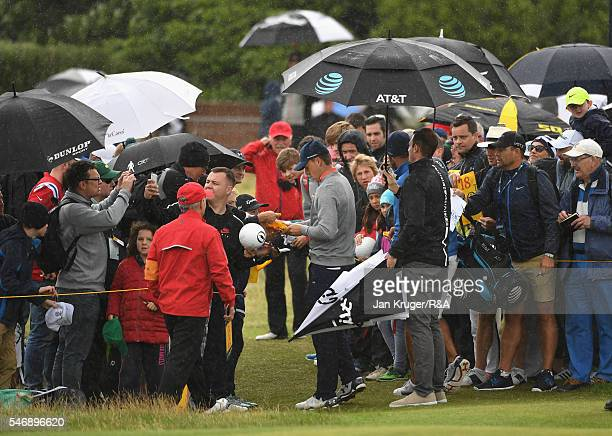 Jordan Spieth of the United States signs autographs during previews to the 145th Open Championship at Royal Troon on July 13 2016 in Troon Scotland
