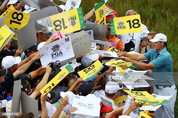 Jordan Spieth of the United States signs autographs for fans during a practice round prior to the 2015 PGA Championship at Whistling Straits on...