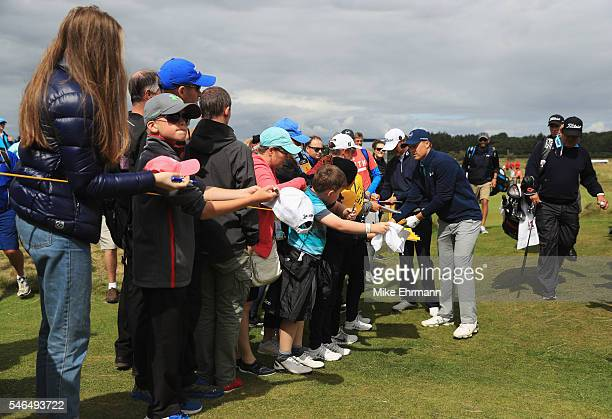 Jordan Spieth of the United States signs autographs for fans during a practice round ahead of the 145th Open Championship at Royal Troon on July 12...