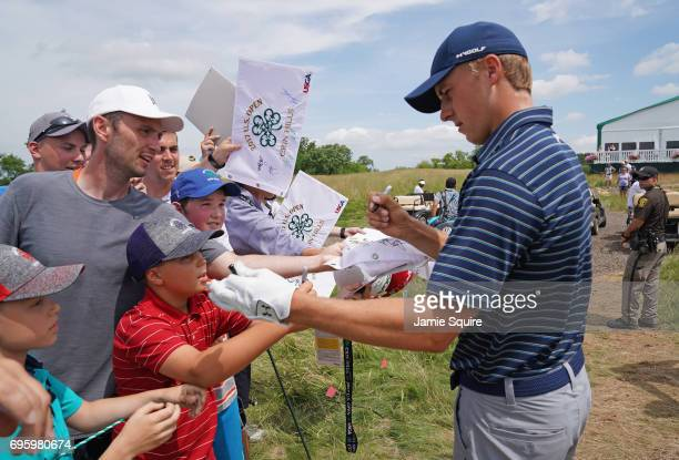 Jordan Spieth of the United States signs autographs for fans during a practice round prior to the 2017 US Open at Erin Hills on June 14 2017 in...