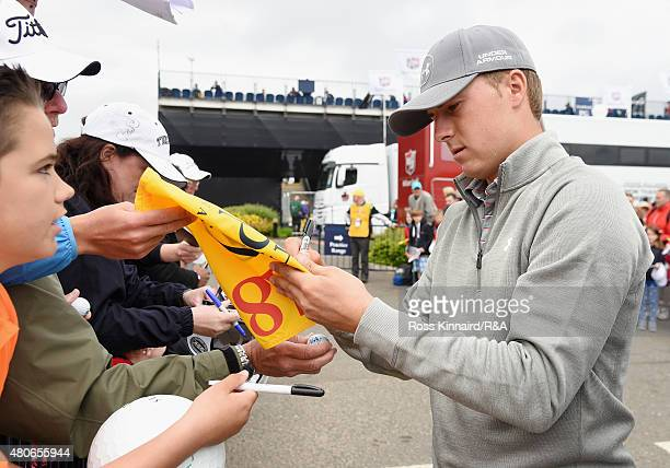 Jordan Spieth of the United States signs his autograph for a fan ahead of the 144th Open Championship at The Old Course on July 14 2015 in St Andrews...