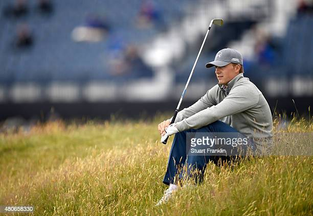 Jordan Spieth of the United States sits down on the course during a practice round ahead of the 144th Open Championship at The Old Course on July 14...