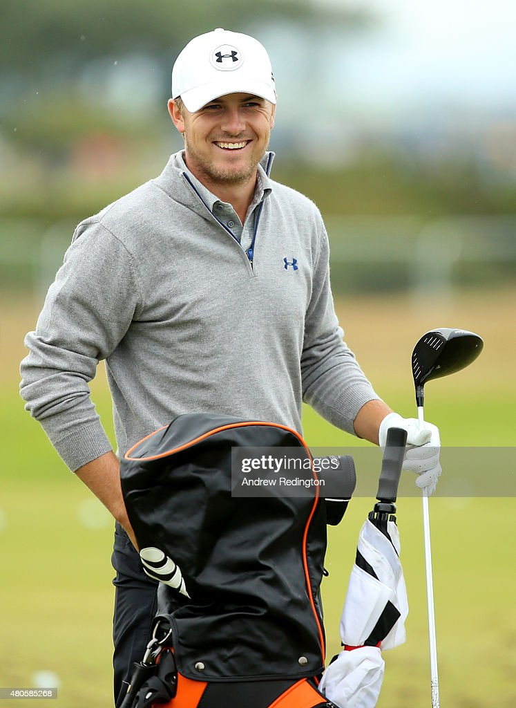 Jordan Spieth of the United States smiles before hitting on the driving range ahead of the 144th Open Championship at The Old Course on July 13, 2015 in St Andrews, Scotland.