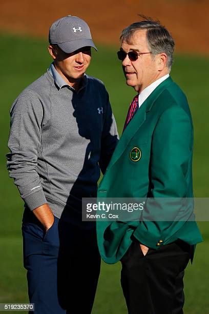 Jordan Spieth of the United States speaks with Chairman of Augusta National William Porter Payne on the practice range during a practice round prior...