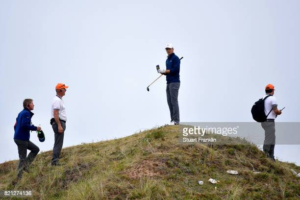 Jordan Spieth of the United States stands on a dune and considers his options on the 13th hole during the final round of the 146th Open Championship...