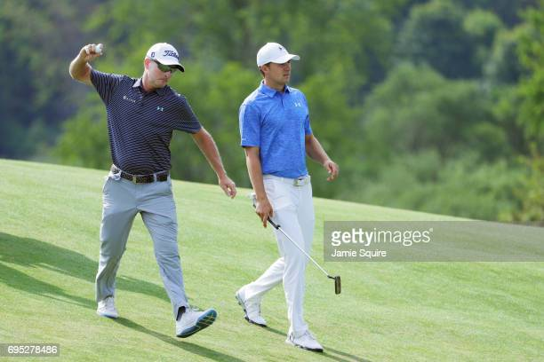 Jordan Spieth of the United States talks to coach Cam McCormick during a practice round prior to the 2017 US Open at Erin Hills on June 12 2017 in...
