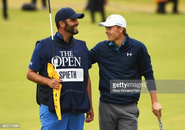 Jordan Spieth of the United States talks with caddie Michael Greller on the 18th green on the way to winning the 146th Open Championship at Royal...