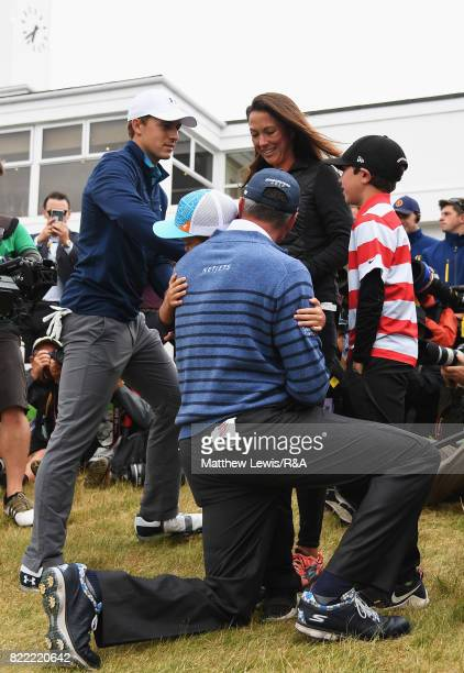 Jordan Spieth of the United States talks with Matt Kuchar's family after winning the 146th Open Championship at Royal Birkdale on July 23 2017 in...