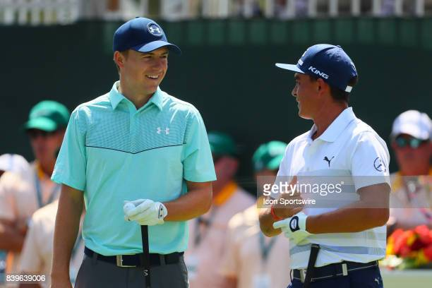 Jordan Spieth of the United States talks with Rickie Fowler of the United States on the first tee during the third round of The Northern Trust PGA...