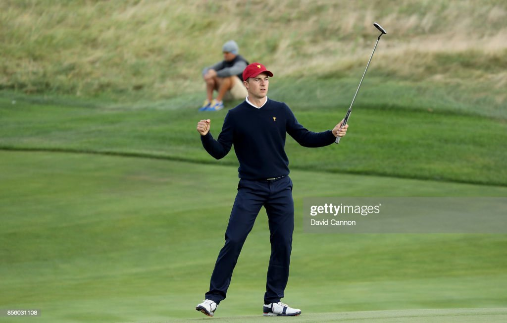 Jordan Spieth of the United States team celebrates holing the match winning putt on the 17th green in his match with Patrick Reed in their match against Jason Day and Louis Oosthuizen of the International team during the Saturday afternoon fourball matches in the 2017 Presidents Cup at the Liberty National Golf Club on September 30, 2017 in Jersey City, New Jersey.