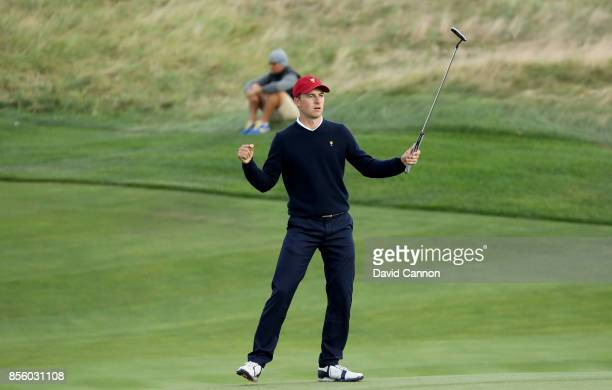 Jordan Spieth of the United States team celebrates holing the match winning putt on the 17th green in his match with Patrick Reed in their match...