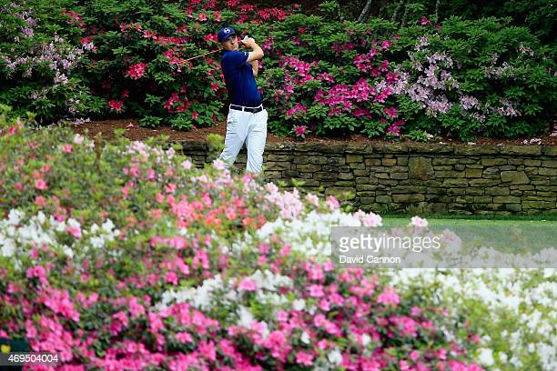 Jordan Spieth of the United States tee off on the 13th hole during the final round of the 2015 Masters Tournament at Augusta National Golf Club on...