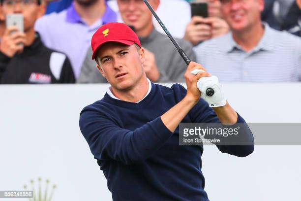 Jordan Spieth of the United States tees off at the 4th hole during Saturday fourball matches of the Presidents Cup at Liberty National Golf Club on...