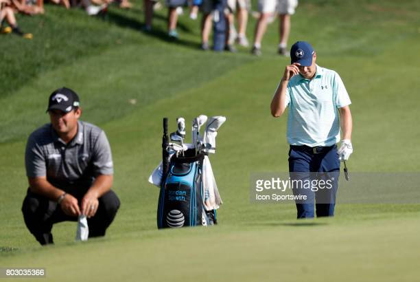 Jordan Spieth of the United States tips his hat to the crowd after nearly holing out from the bunker on 15 during the third round of the Travelers...