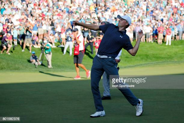 Jordan Spieth of the United States tosses his ball to the gallery during the final round of the Travelers Championship on June 25 at TPC River...