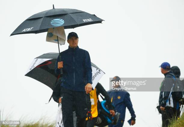 Jordan Spieth of the United States under an umbrella on the 8th hole during the second round of the 146th Open Championship at Royal Birkdale on July...