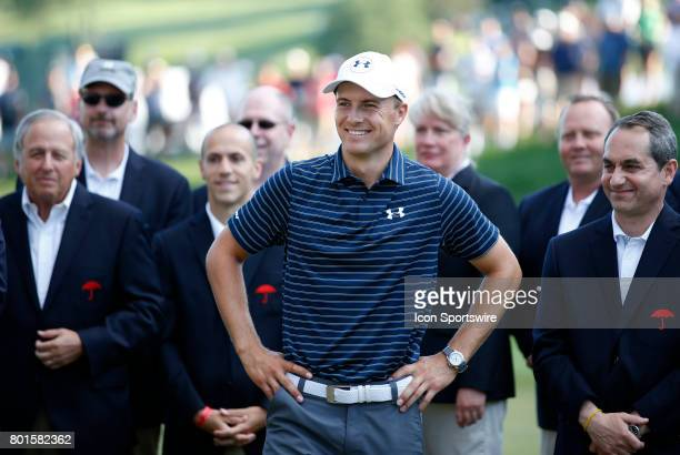 Jordan Spieth of the United States waits for his jacket during the final round of the Travelers Championship on June 25 at TPC River Highlands in...