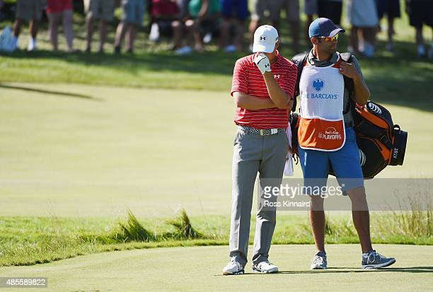 Jordan Spieth of the United States waits on the 12th hole with his caddie Michael Greller during the second round of The Barclays at Plainfield...