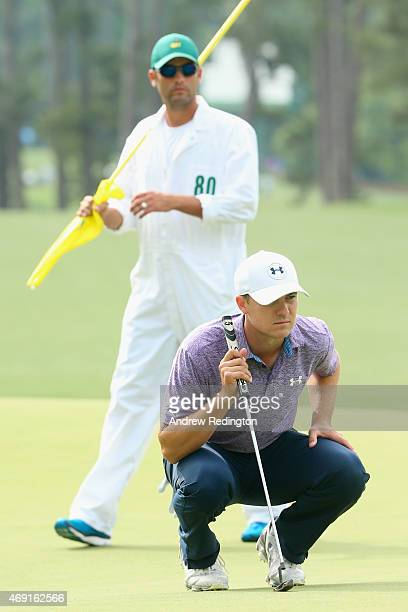 Jordan Spieth of the United States waits on the first green with his caddie Michael Greller during the second round of the 2015 Masters Tournament at...
