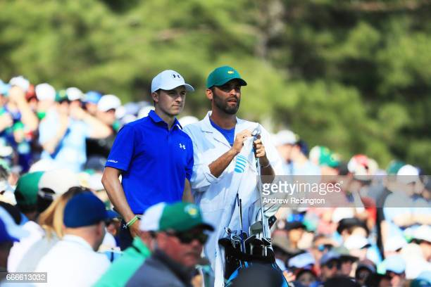 Jordan Spieth of the United States waits with caddie Michael Greller on the 12th tee during the final round of the 2017 Masters Tournament at Augusta...