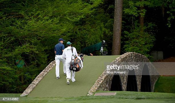 Jordan Spieth of the United States walk over Hogan Bridge during the final round of the 2015 Masters at Augusta National Golf Club on April 12 2015...