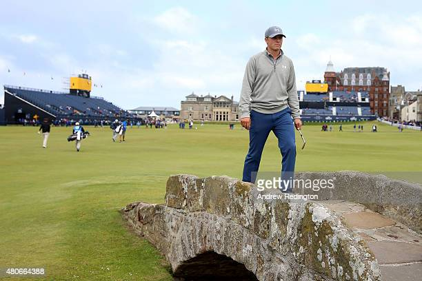 Jordan Spieth of the United States walks across Swilcan Bridge during practice ahead of the 144th Open Championship at The Old Course on July 14 2015...