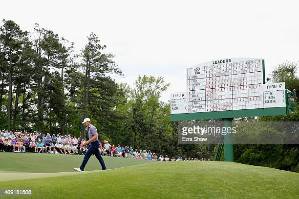 Jordan Spieth of the United States walks across the 18th green during the second round of the 2015 Masters Tournament at Augusta National Golf Club...