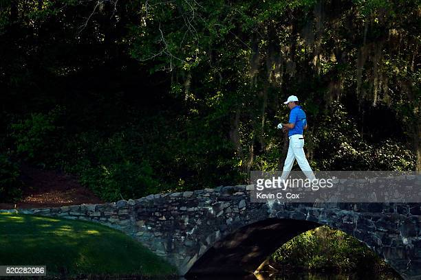 Jordan Spieth of the United States walks across the Nelson bridge to the 12th green during the final round of the 2016 Masters Tournament at Augusta...