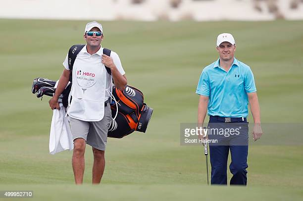 Jordan Spieth of the United States walks alongside his caddie Michael Greller to the first green during the second round of the Hero World Challenge...