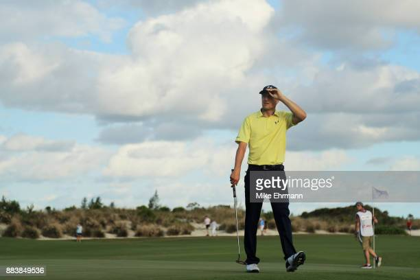 Jordan Spieth of the United States walks off of the 18th green after finishing the second round of the Hero World Challenge at Albany Bahamas on...