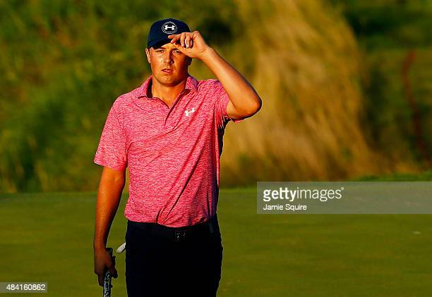 Jordan Spieth of the United States walks off the 18th green after a sevenunder par 65 during the third round of the 2015 PGA Championship at...
