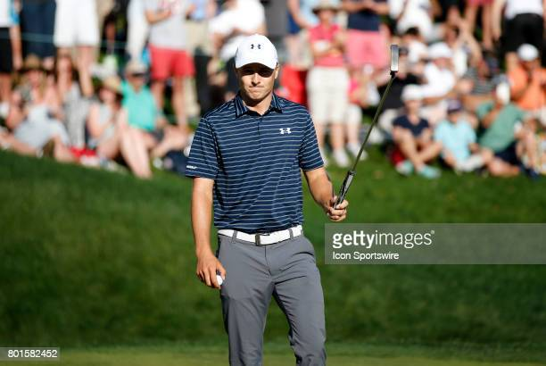 Jordan Spieth of the United States walks off the 18th green and into a playoff during the final round of the Travelers Championship on June 25 at TPC...