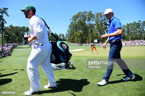 Jordan Spieth of the United States walks off the second hole after making a putt for birdie during the final round of the 2017 Masters Tournament at...