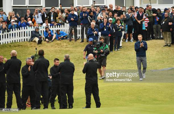 Jordan Spieth of the United States walks out for the trophy presentation after winning the 146th Open Championship at Royal Birkdale on July 23 2017...