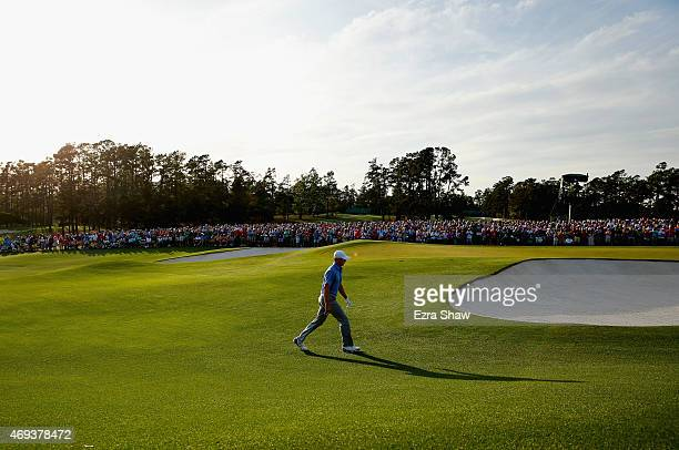 Jordan Spieth of the United States walks up to the 18th green during the third round of the 2015 Masters Tournament at Augusta National Golf Club on...