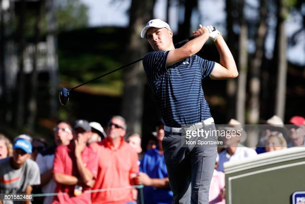 Jordan Spieth of the United States watches his drive on 18 during the final round of the Travelers Championship on June 25 at TPC River Highlands in...