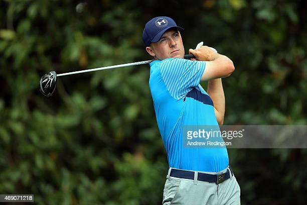 Jordan Spieth of the United States watches his tee shot on the 11th hole during the first round of the 2015 Masters Tournament at Augusta National...