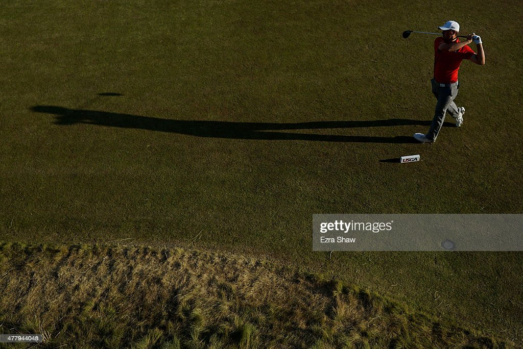 Jordan Spieth of the United States watches his tee shot on the 18th hole during the third round of the 115th U.S. Open Championship at Chambers Bay on June 20, 2015 in University Place, Washington.