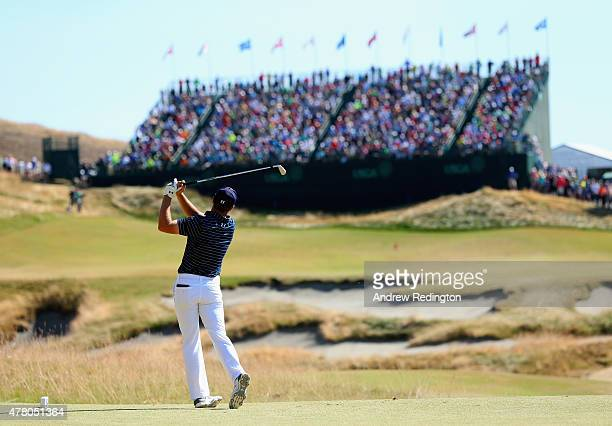 Jordan Spieth of the United States watches his tee shot on the ninth hole during the final round of the 115th US Open Championship at Chambers Bay on...