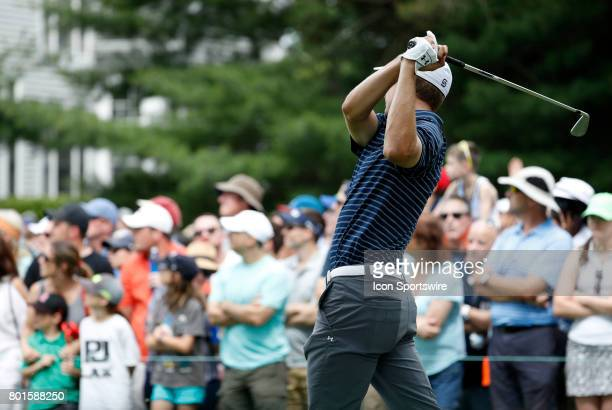 Jordan Spieth of the United States watches his tee shot on9 during the final round of the Travelers Championship on June 25 at TPC River Highlands in...
