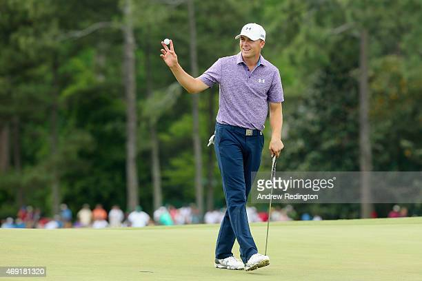 Jordan Spieth of the United States waves to the gallery on the 18th green after a sixunder par 66 during the second round of the 2015 Masters...