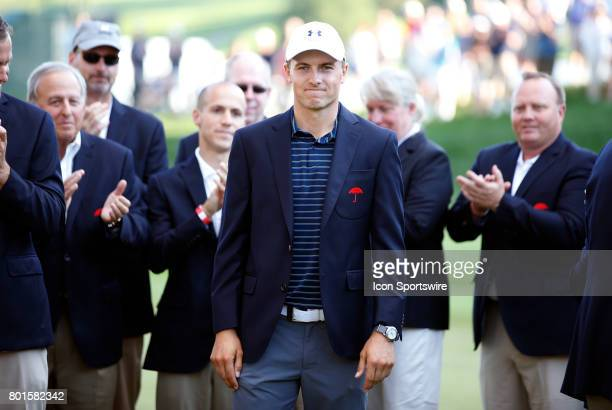 Jordan Spieth of the United States wears the winner's jacket during the final round of the Travelers Championship on June 25 at TPC River Highlands...