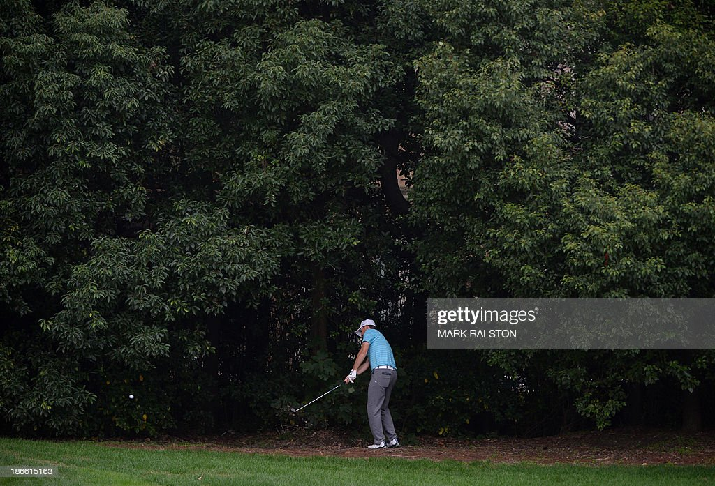 Jordan Spieth of the US plays from the rough at the 7th hole on day three of the WGC-HSBC Champions tournament at the Shanghai Sheshan International Golf Club on November 2, 2013. AFP PHOTO/Mark RALSTON