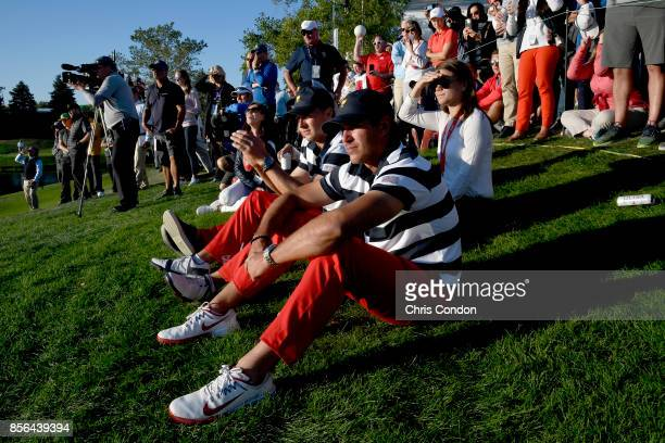 Jordan Spieth of the US Team and Brooks Koepka of the US Team watch the action during the Sunday singles matches at the Presidents Cup at Liberty...
