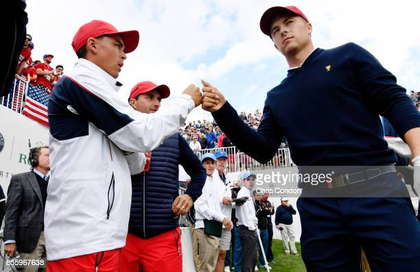 Jordan Spieth of the US Team firstbumps teammate Rickie Fowler as he leaves the first tee during the afternoon fourball matches at the Presidents Cup...