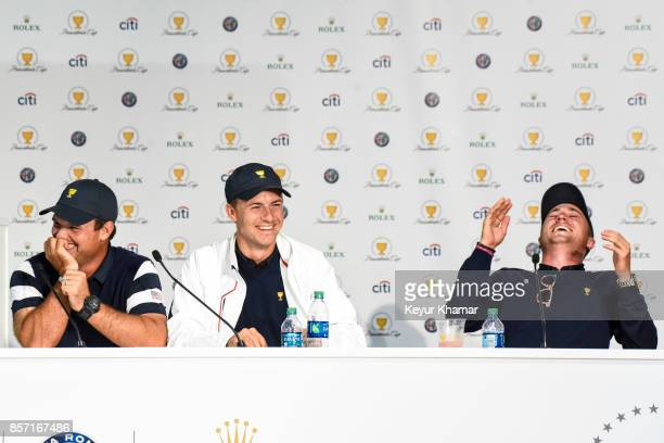 Jordan Spieth of the US Team laughs as he recites a Fanatics song about Si Woo Kim with Patrick Reed and Justin Thomas during a press conference...