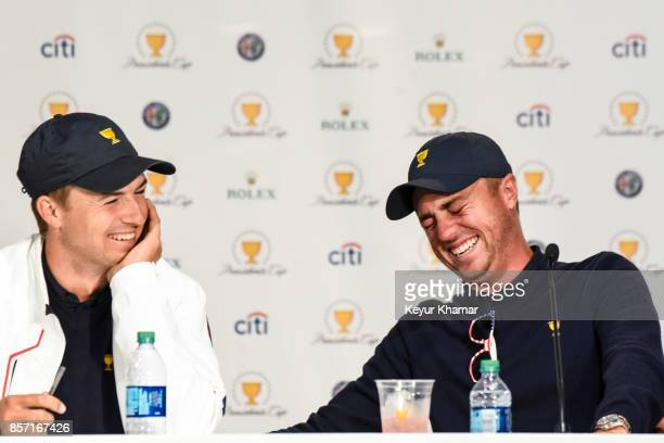 Jordan Spieth of the US Team laughs with Justin Thomas as he recites a Fanatics song about Si Woo Kim during a press conference following the team's...