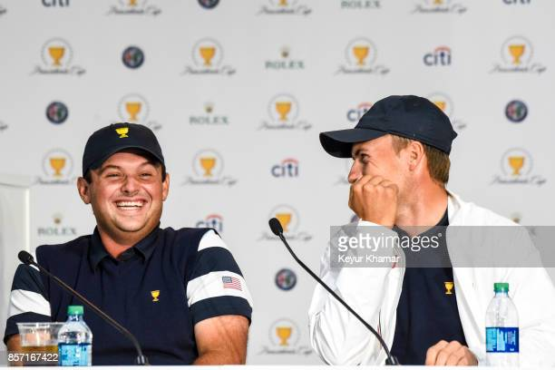 Jordan Spieth of the US Team laughs with Patrick Reed during a press conference following the team's victory after Sunday Singles matches at the...