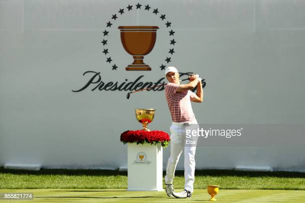Jordan Spieth of the US Team plays his shot from the first tee during Friday fourball matches of the Presidents Cup at Liberty National Golf Club on...